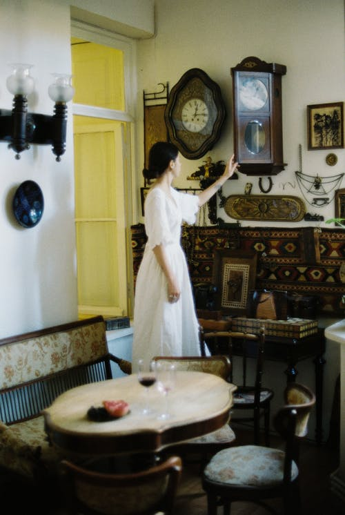 Woman in dress checking time at clock