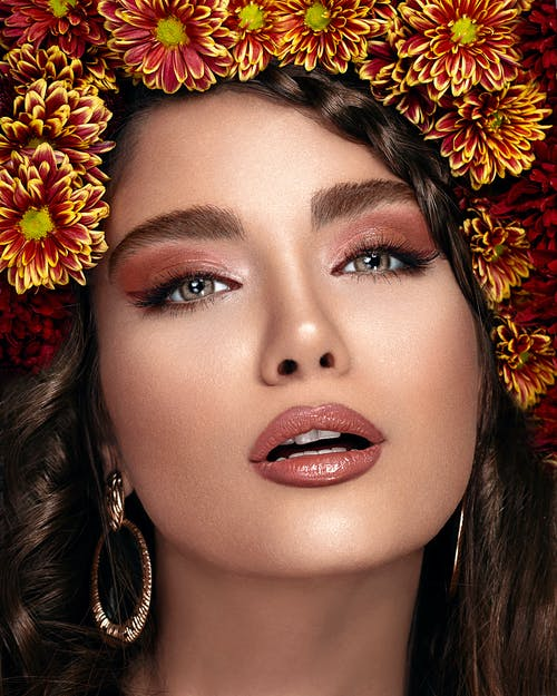 Crop gorgeous woman with makeup and floral wreath