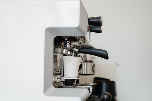 Photo of White Cup on Espresso Machine