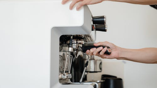 Person Using Espresso Machine