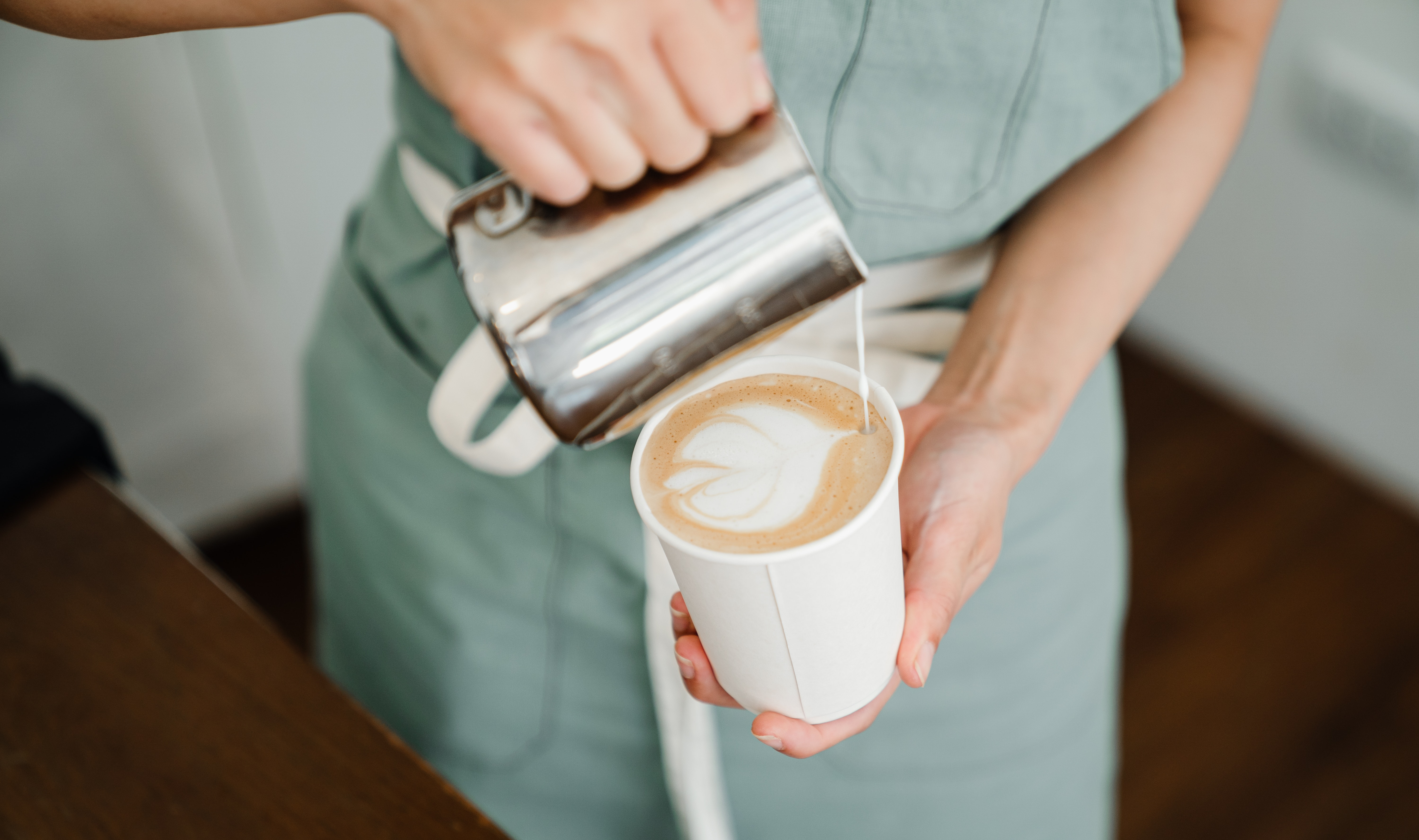 Latte Art By Crop Faceless Person In Coffee Shop Free Stock Photo