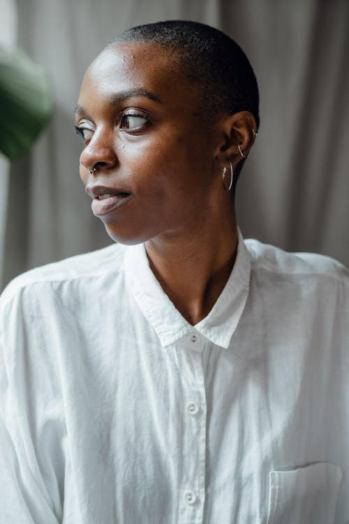 Content black woman in white blouse
