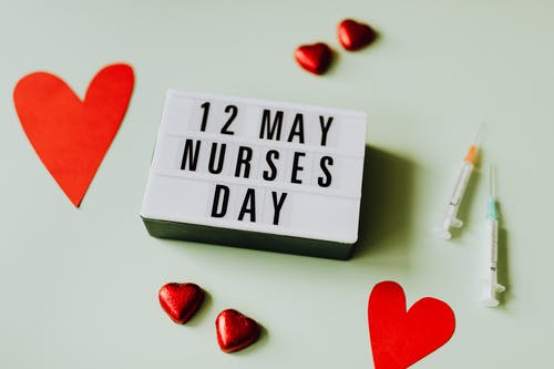 Nurses Day Sign with Hearts and Syringes