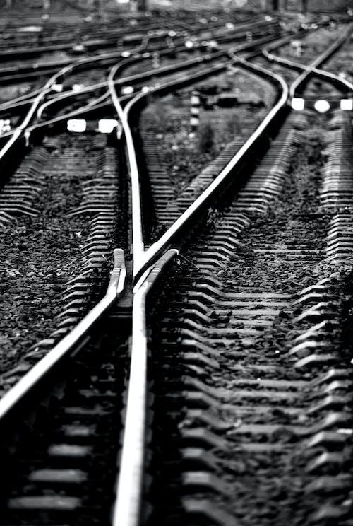 Wavy shiny metal railroad on pebble terrain