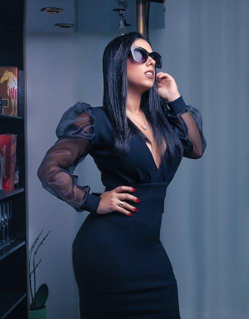 Woman in Black Dress Wearing Black Sunglasses