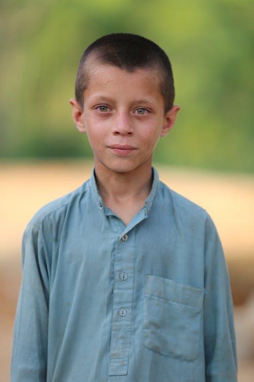 Boy in Blue Button Up Shirt