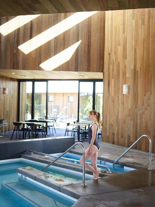 Photo of Woman in Black Bikini Standing on Poolside