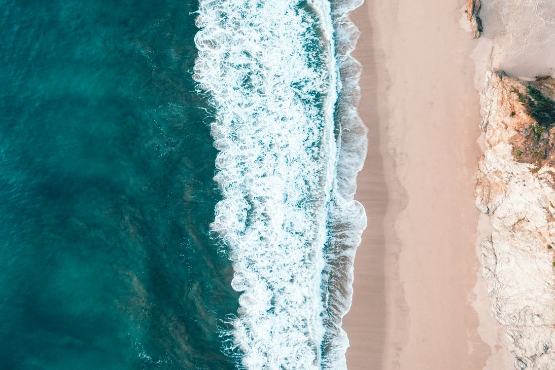 Aerial View of Sea Waves on Seashore