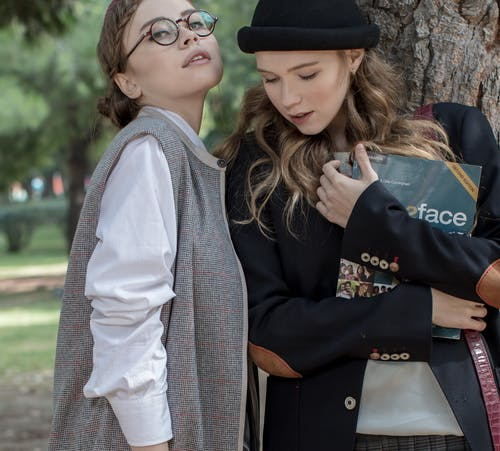 Students Holding Book
