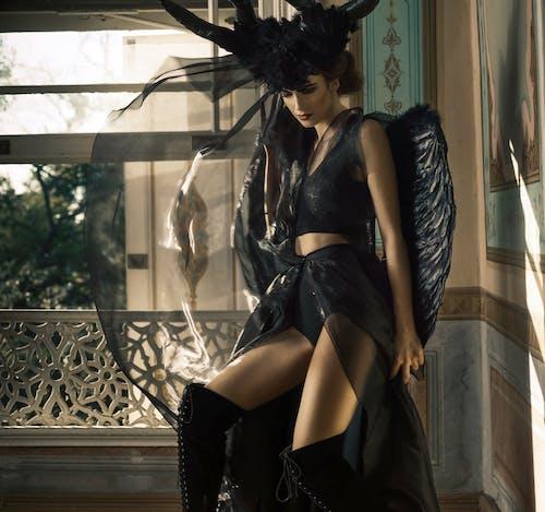 Woman in Black Angel Costume