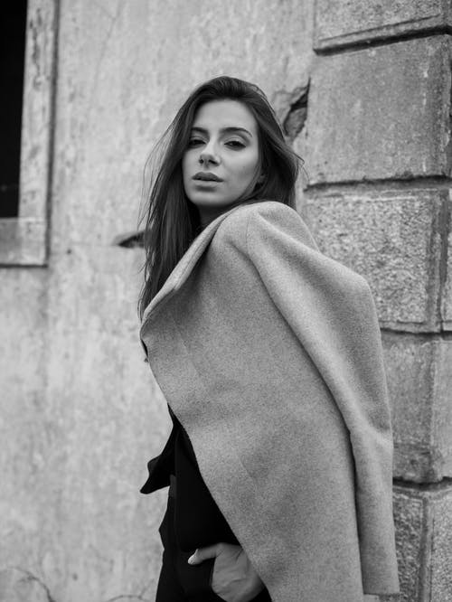 Grayscale Photo of Woman in Coat