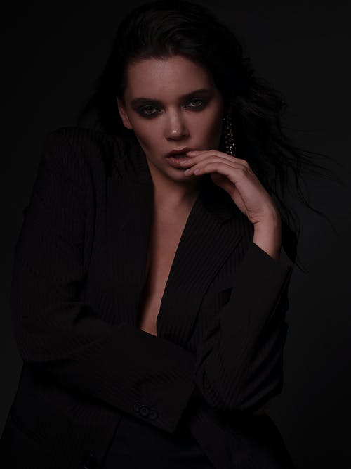 Stylish woman with dark makeup in black jacket