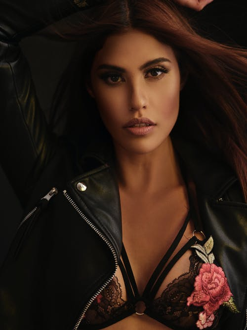 Alluring woman in bra and leather jacket