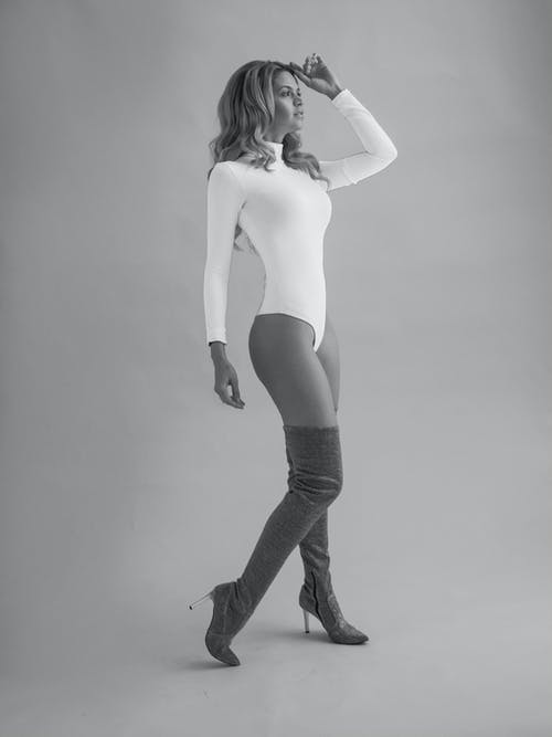 Woman in White Body and Boots