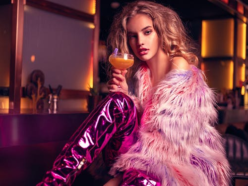 Woman in Fur Coat Holding Cocktail