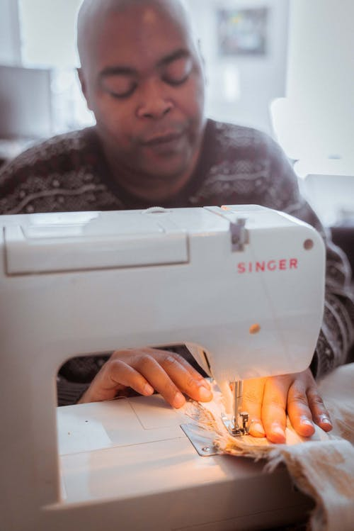 Crop concentrated black tailor stitching on sewing machine