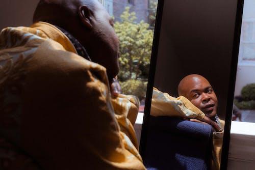 Serene black man looking in mirror