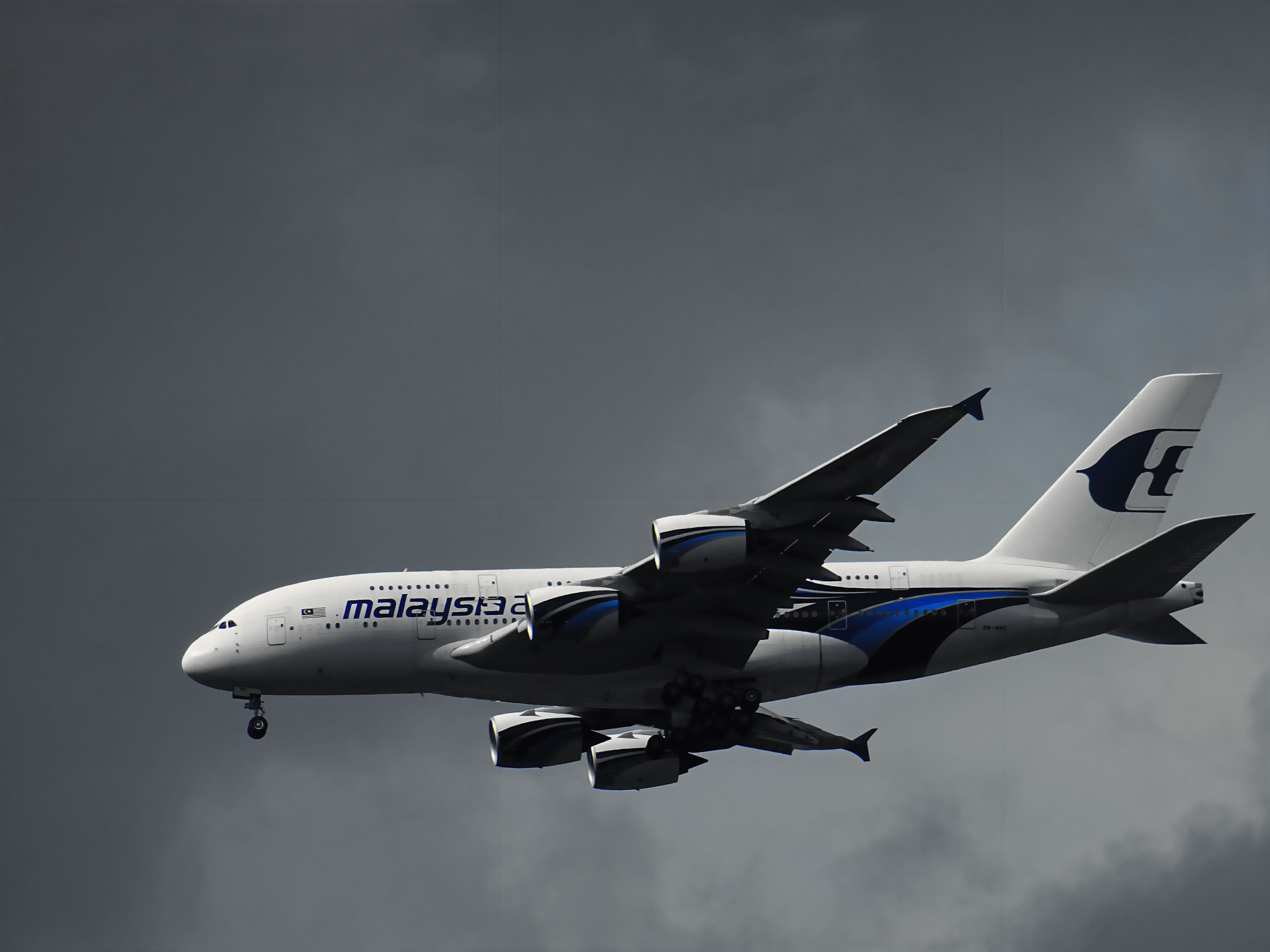 White Malaysian Airlines Under White Clouds