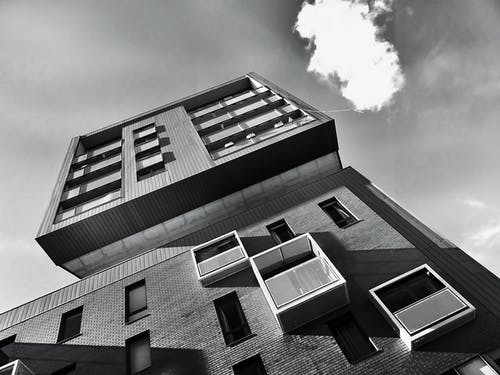 Low-angle Photo of Gray Mid-high Concrete Building