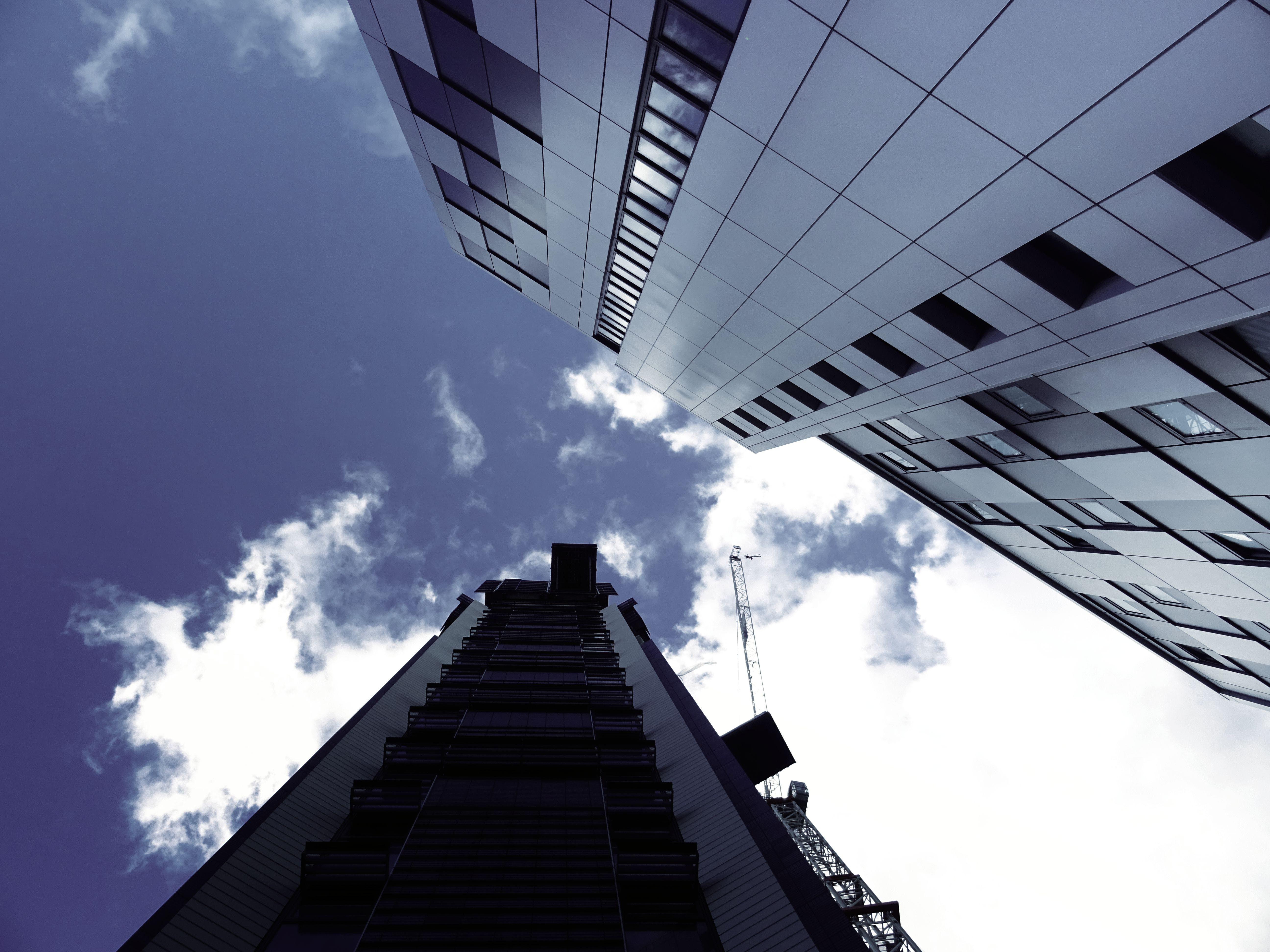 Buildings Under Cloudy Sky