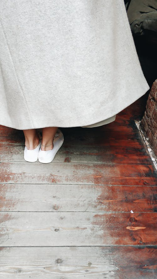 Person in White Skirt and White Flats