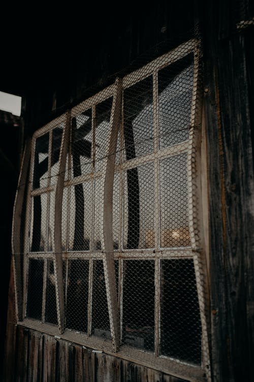 Windows of weathered lumber barn in countryside
