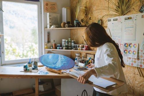 A Woman Working in an Art Studio