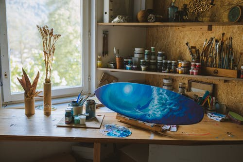 Blue and White Ceramic Bowl on Brown Wooden Table