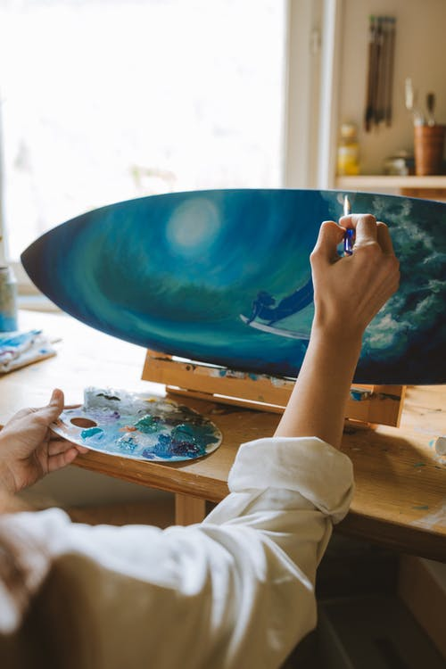 Person Holding Blue and White Abstract Painting