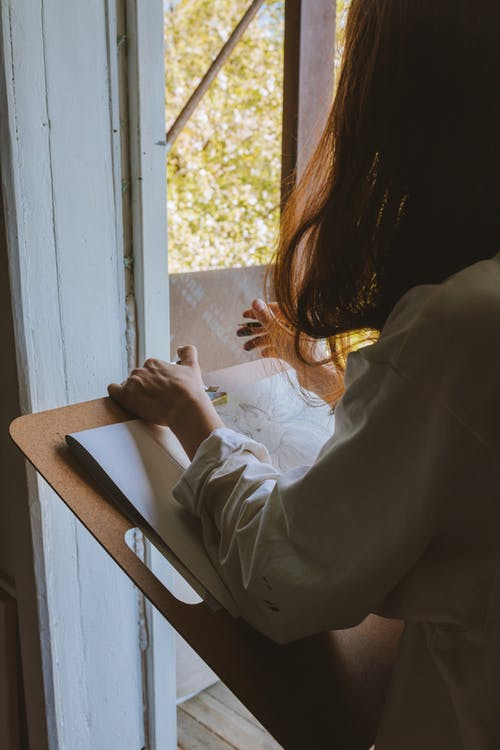 A Woman Drawing on a Paper