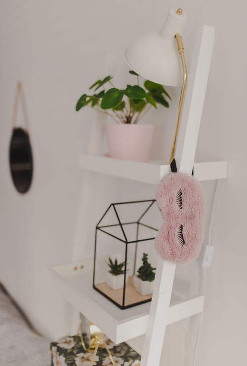 Pink Plush Toy on White Wooden Shelf