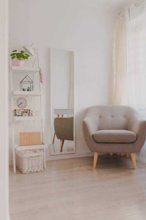 White Sofa Chair Beside White Wall
