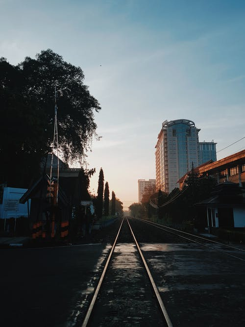 Railway road in city outskirts during sunset
