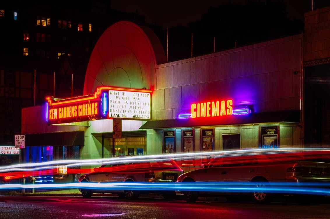 brightly lit cinema at night
