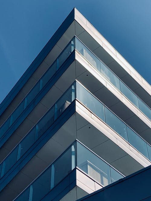 Facade of contemporary building with glass balconies