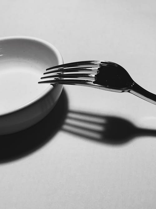 Silver fork placed on white plate