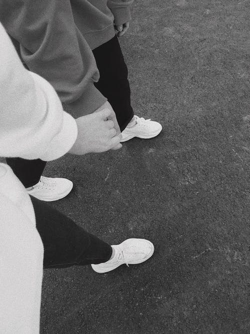 People in Black Pants and White Sneakers