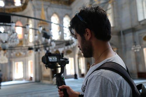 Man in Gray Crew Neck T-shirt Holding Black Dslr Camera