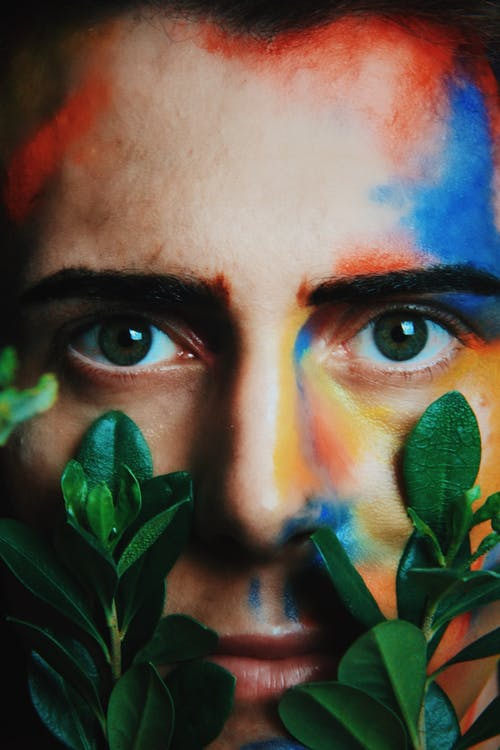 Green Leaves on Persons Face