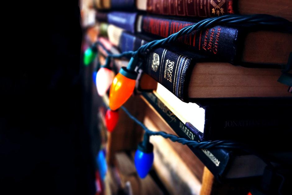 book stack, books, christmas lights