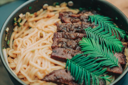 Photo of Noodles With Meat and Garnish