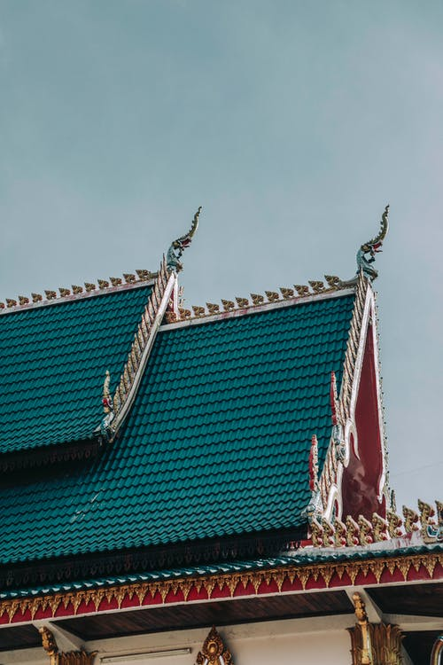 Ribbed roof of old Asian temple under sky