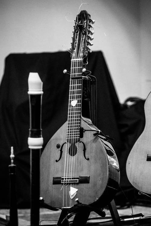 Mandolin near musical instruments on stage indoors