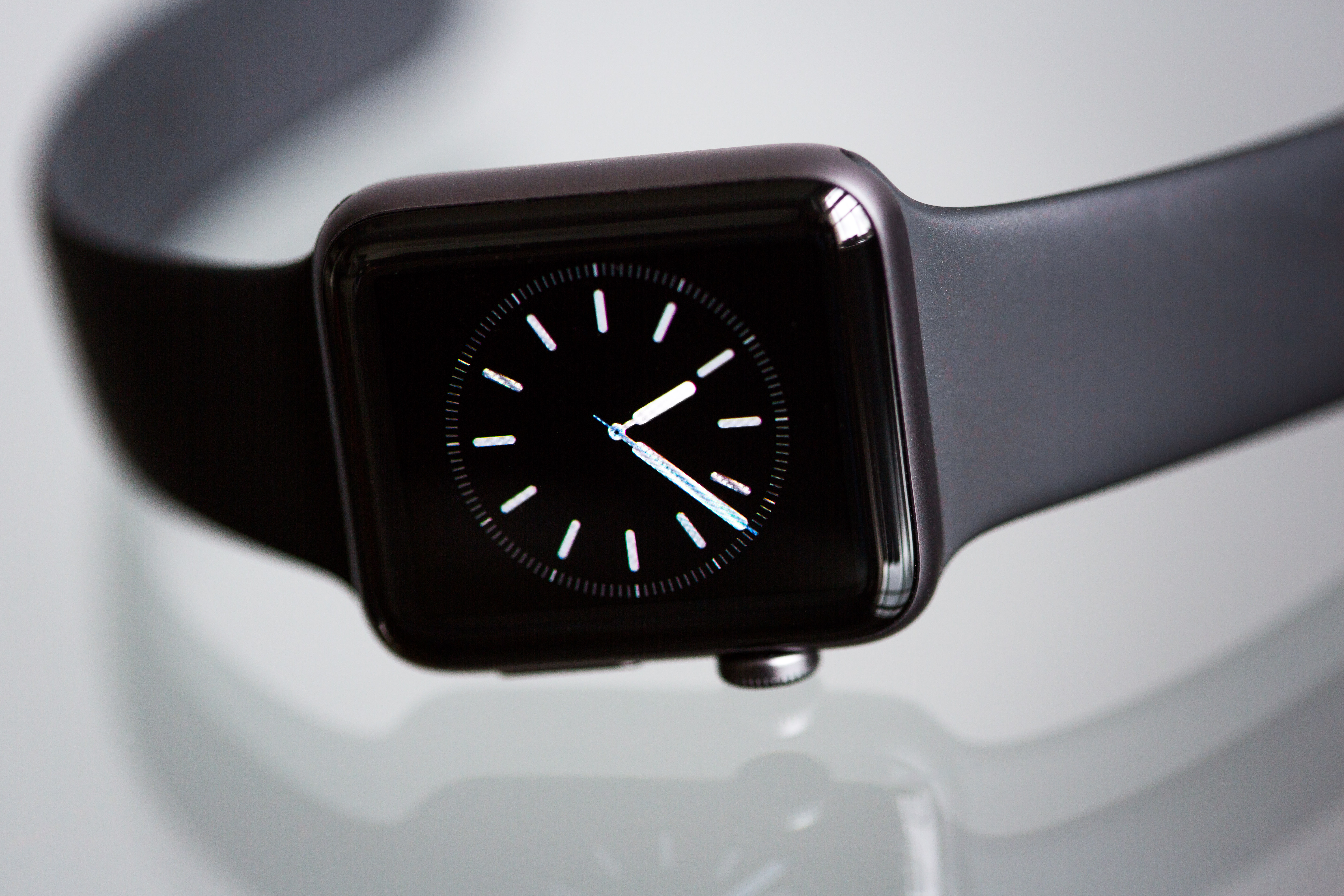 Black Apple Watch With Black Sports Band Displaying 10:06
