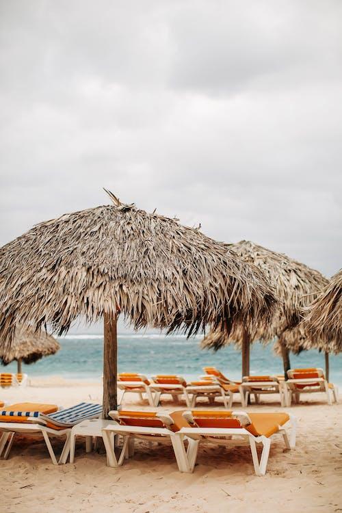 Photo of Nipa Umbrellas on Beach