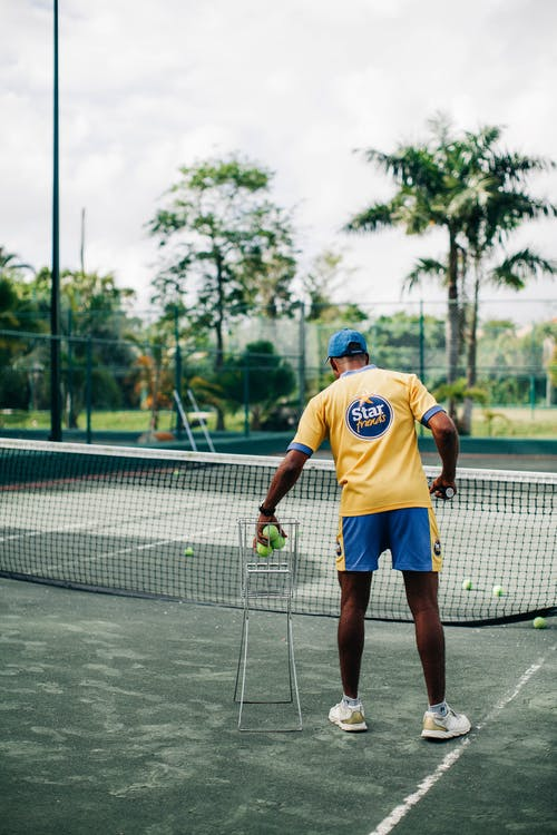 Photo of Man Playing Tennis