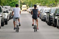 Photo of Couple Riding Bicycle