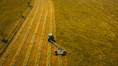 Aerial Photo of Tractor Landscape Rake on Grass Field