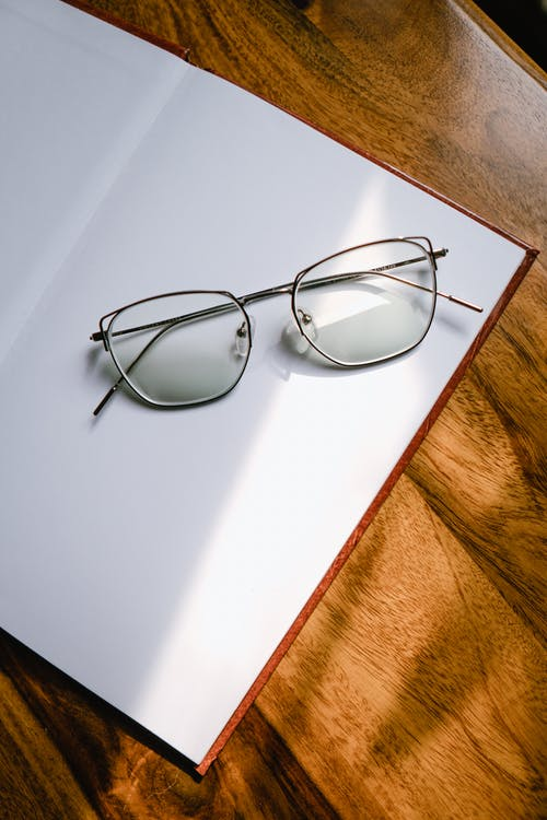 Black Framed Eyeglasses on White Table