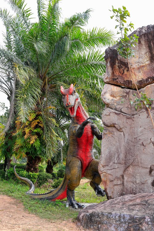 dinozor bahçesi, dinozor modeli içeren Ücretsiz stok fotoğraf